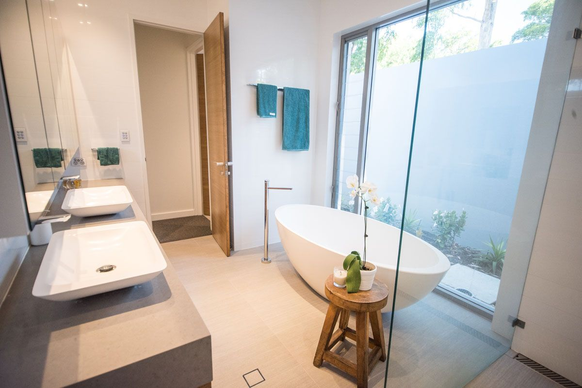 Gorgeous Master Bathroom With Standalone Tub And Glass Shower!  Vanity/countertop Uses Caesarstone 4130