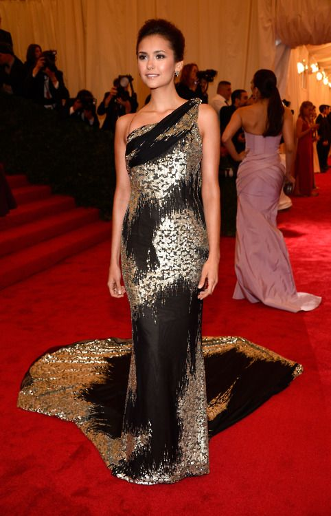 Nina Dobrev in Donna Karanattends the 'Schiaparelli And Prada: Impossible Conversations' Costume Institute Gala at the Metropolitan Museum of Art on May 7, 2012 in New York City.