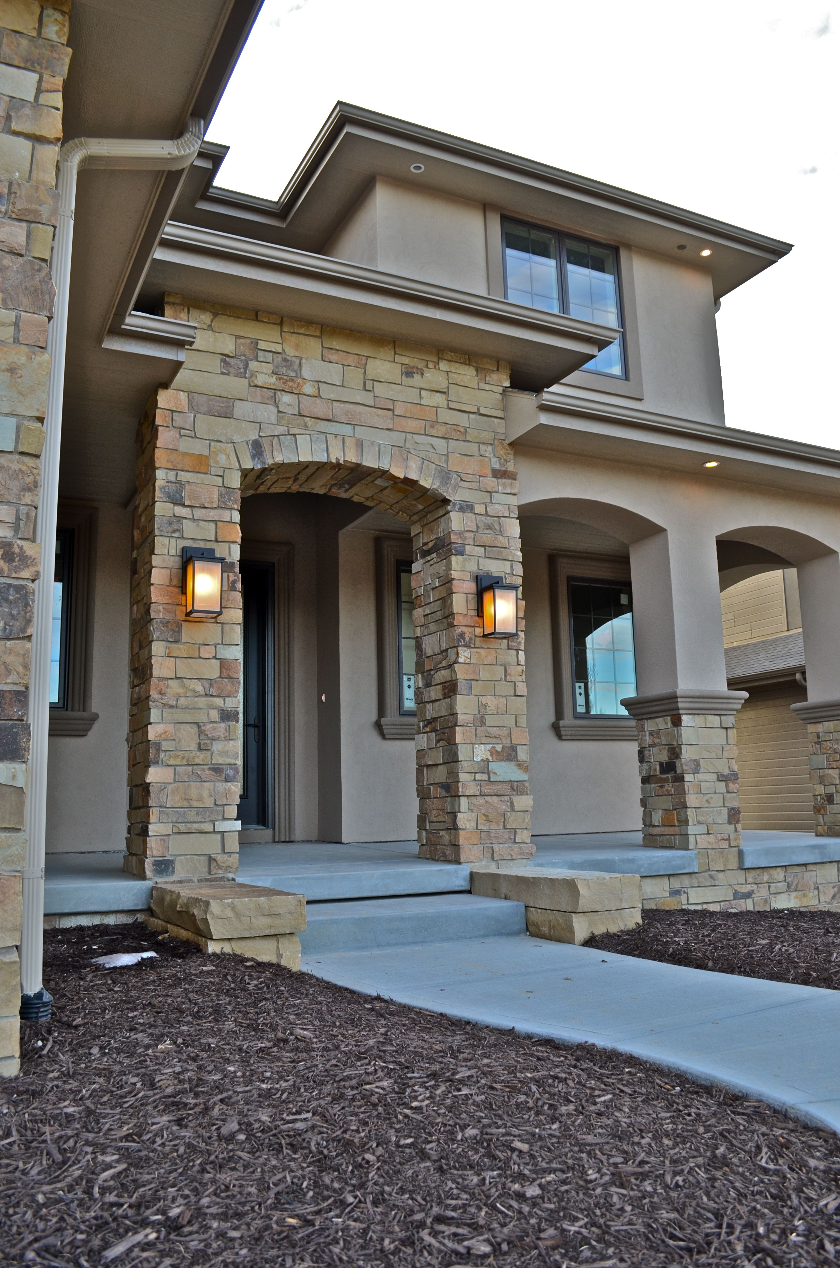 Exterior stone stucco entrance anchored by clean line - Exterior paint coverage on stucco ...