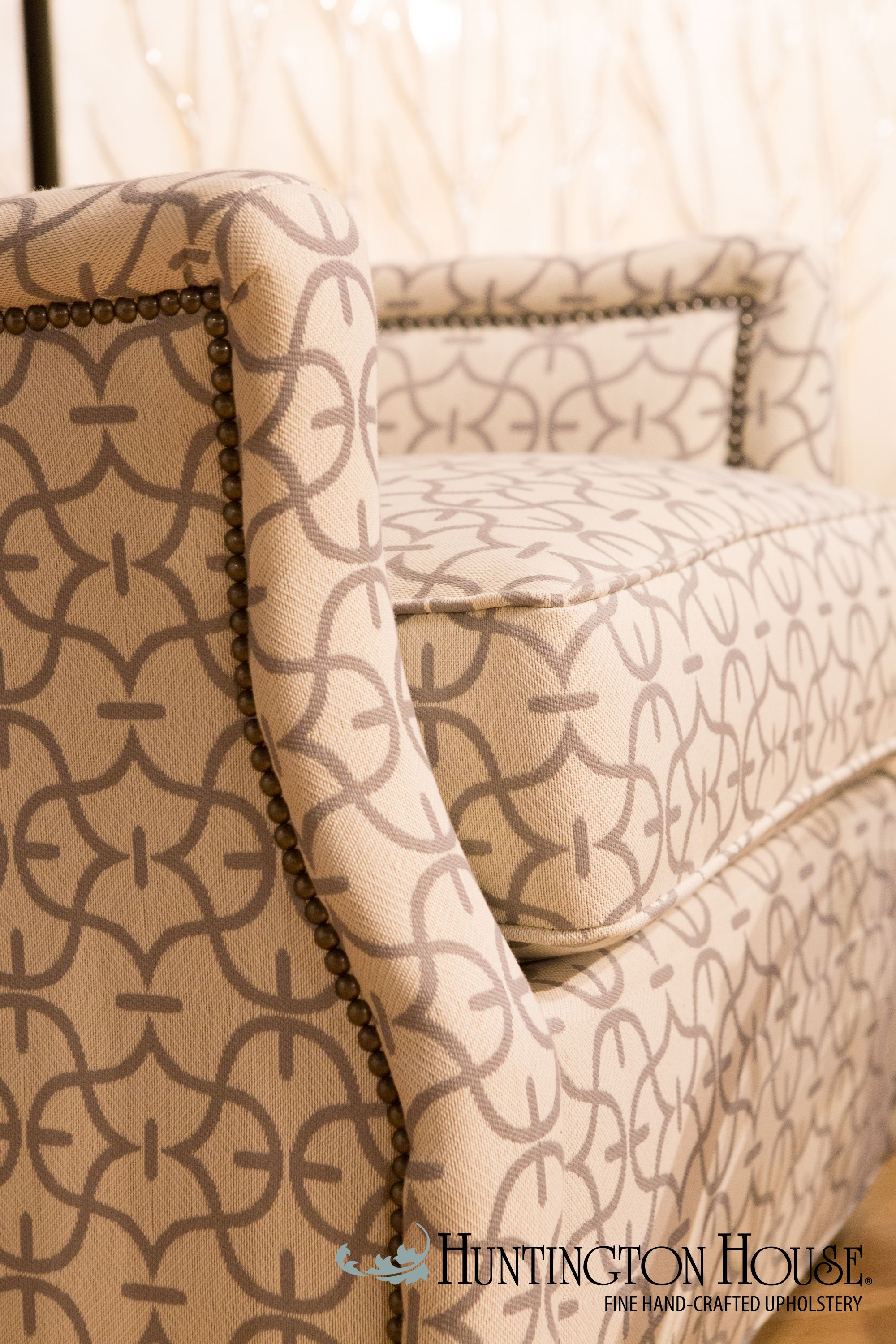 Nailhead trim helps define and accentuate the unique curves of