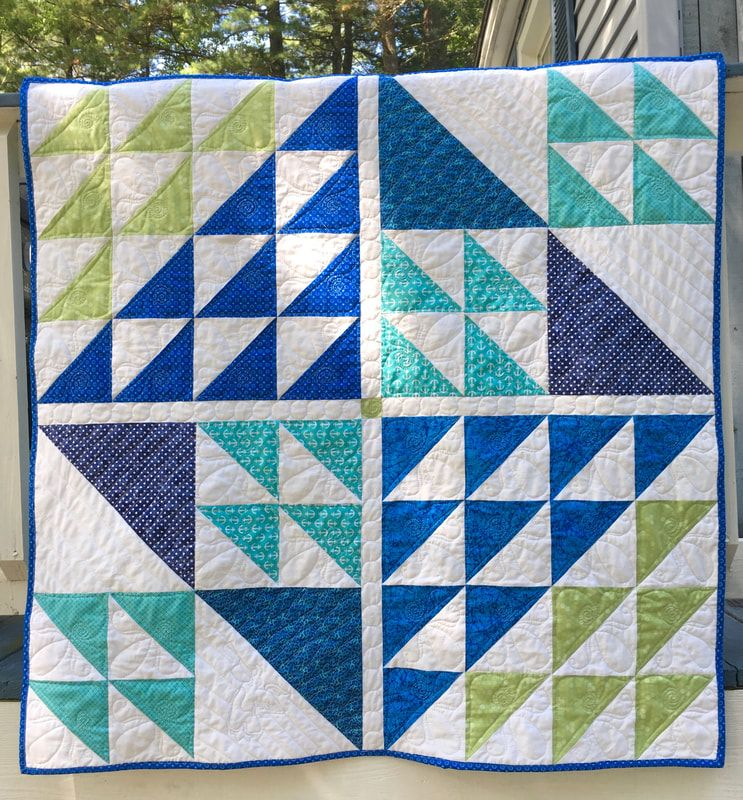 Modern Style Baby Quilt from http://www.HomeSEwnByCarolyn.com