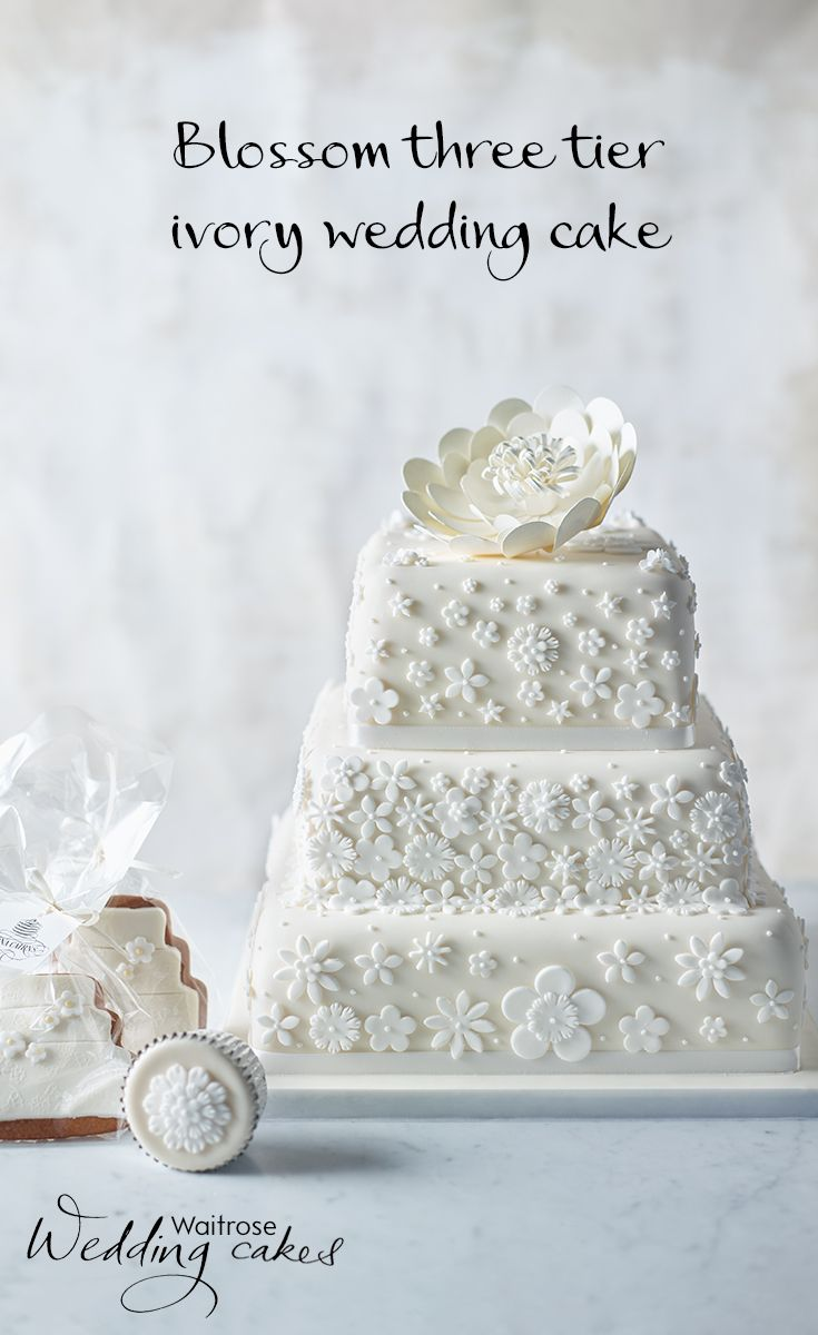 This beautiful floral wedding cake is covered in sugar paste icing ...