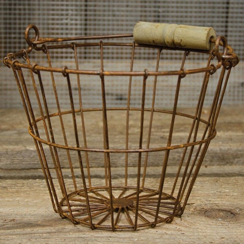 """CWI Wire Egg Basket - Rusty G7346A Memphis - CWI Wire Egg Basket - Rusty G7346AThe Wire Egg Basket Is A Perfect Farmhouse Display Piece For Kitchen Goods, Eggs, Towels, Or Soaps. Rusted Metal Wire Basket With Tapered Sides And A Weathered Wooden Handle. 6"""" H, 8"""" In Diameter At Lip, 4-1/2"""" At Base.SKU: G7346AManufacturer: CWICategory 1: ContainersCategory 2: Baskets"""