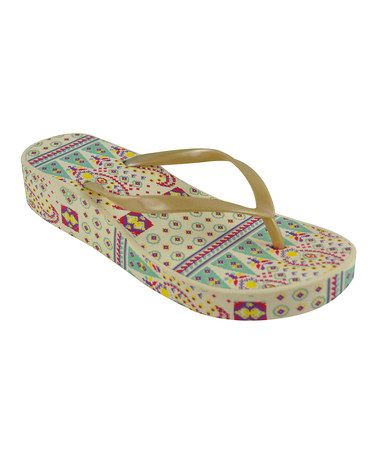 8cb3535c33a Take a look at this Ivory Boho Wedge Flip-Flop - Women by MUK LUKS on   zulily today!