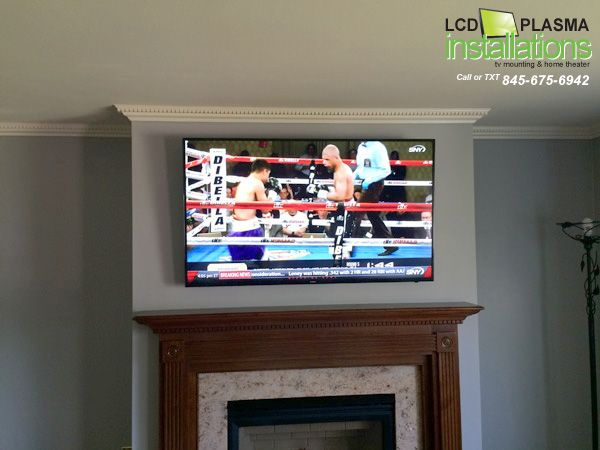 Tv Mounted Above Fireplace With Wires Concealed Inside Wall Outlet Installed Behind All Work Was Done By Lcd Plasma Installations 845 675 6942