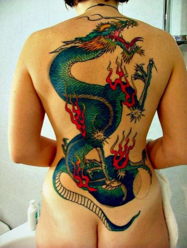 a87572a30 A full back dragon tattoo on a woman of an oriental dragon in traditional  colors