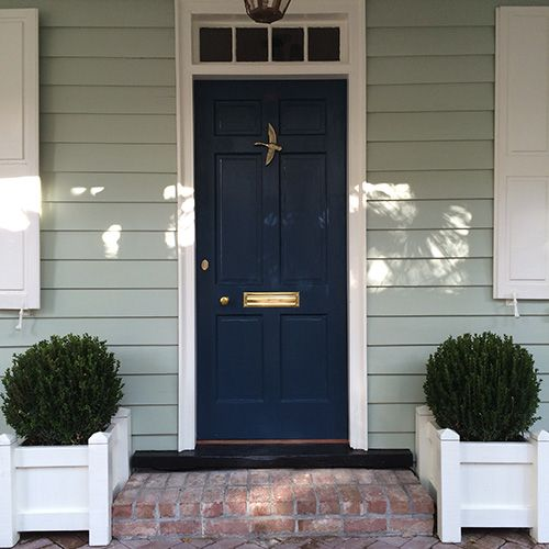 White Brick House With Navy Blue Shutters