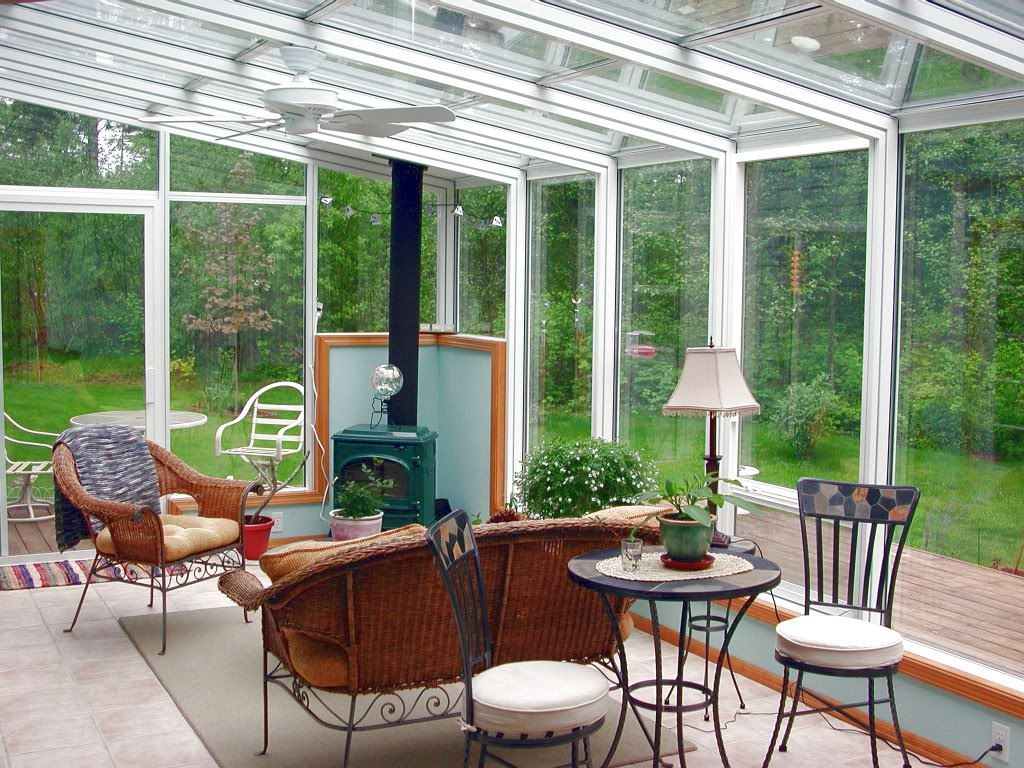 Glass Sunroom With Wood Burning Stove And Tile Flooring For Year Round Living Coastal Va Magazine S Best Kitch Small Sunroom Sunroom Decorating Sunroom Designs