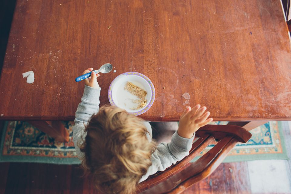 Kid eats breakfast - Family Documentary Photography
