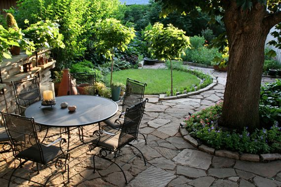 garden ideas. Stone walk with (pallet wood) furniture. I want to do this around the big front yard tree.