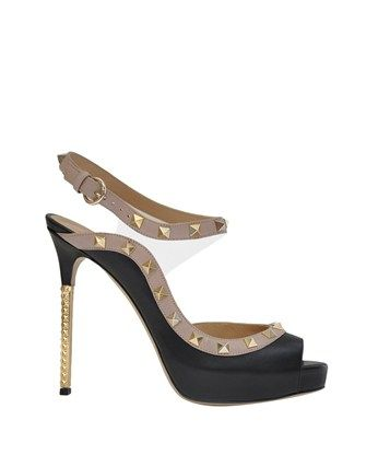 Valentino  Rockstud sandal in leather and pvc  € 670,00