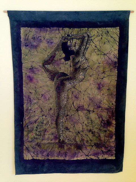 This large Natarajasana batik banner by Darcy Whitten hangs in the stairway of my yoga studio