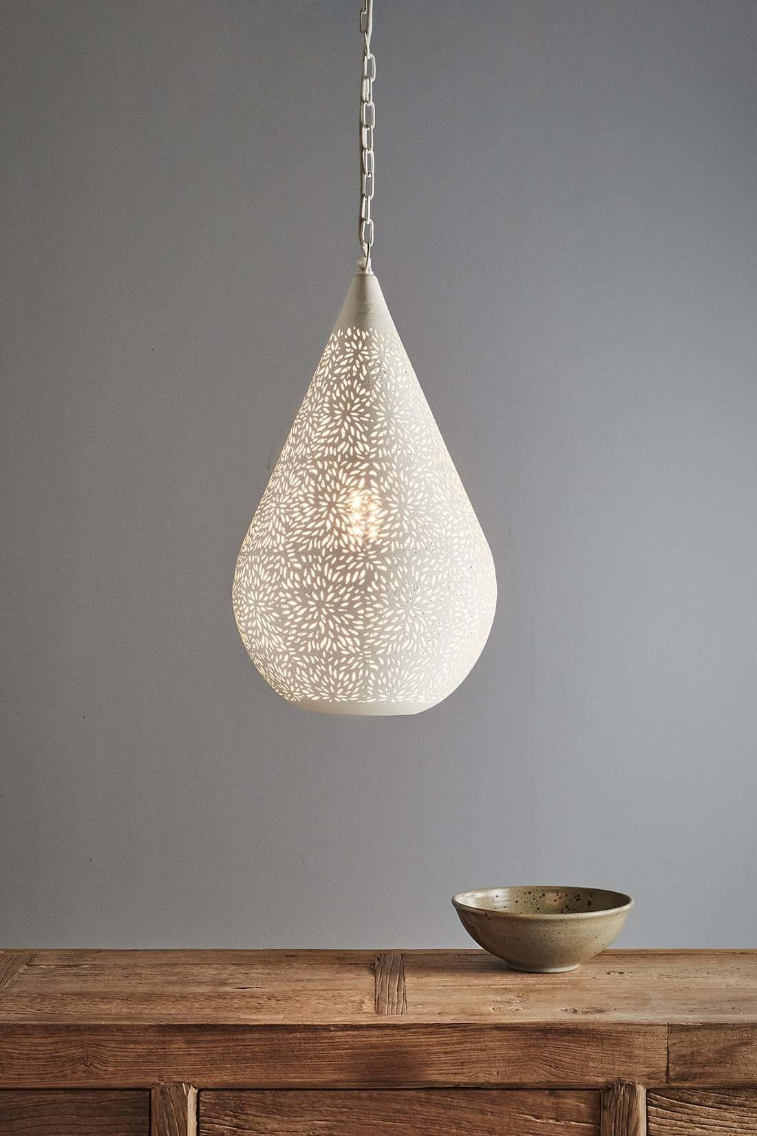 A teardrop pendant featuring a delicately patterned perforated mat when unlit the exterior shows the delicate perforations when illuminated the interior light radiates out a teardrop pendant aloadofball Images