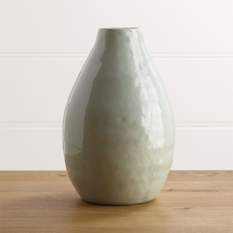 Shop Delia Vases.  A glossy seafoam glaze coats the simple curves of this large vase, handcrafted in Portugal.  Group with other Delia vases for a display of soft, neutral color.