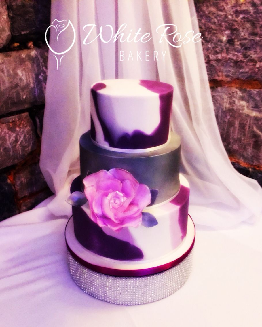 Cadbury\'s purple, marble effect 3 tiered wedding cake, with large ...