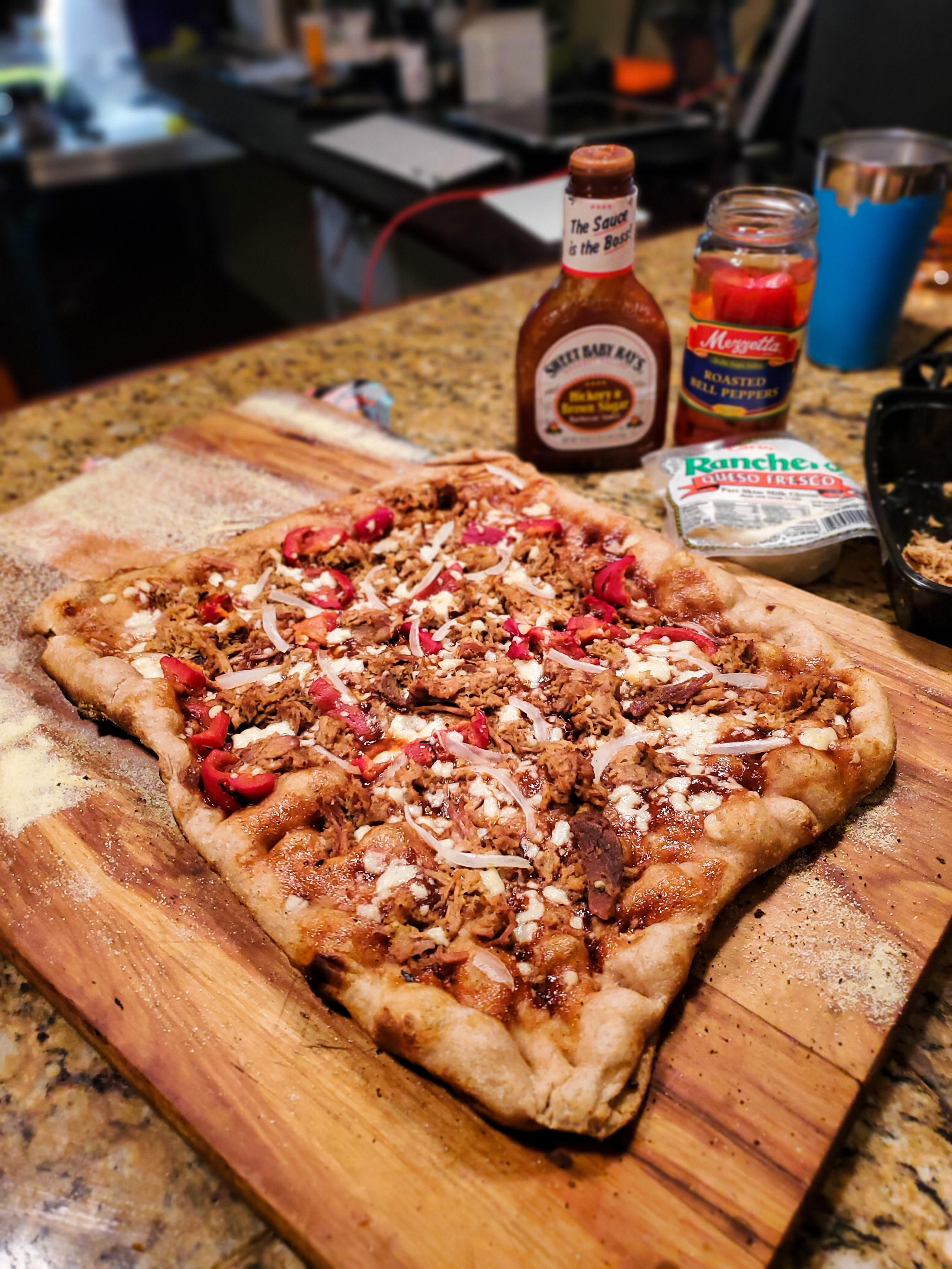 Pulled pork on whole wheat with BBQ sauce roasted red pepper Maui onion and queso fresco. #Pizza #Pizzas #food #foods