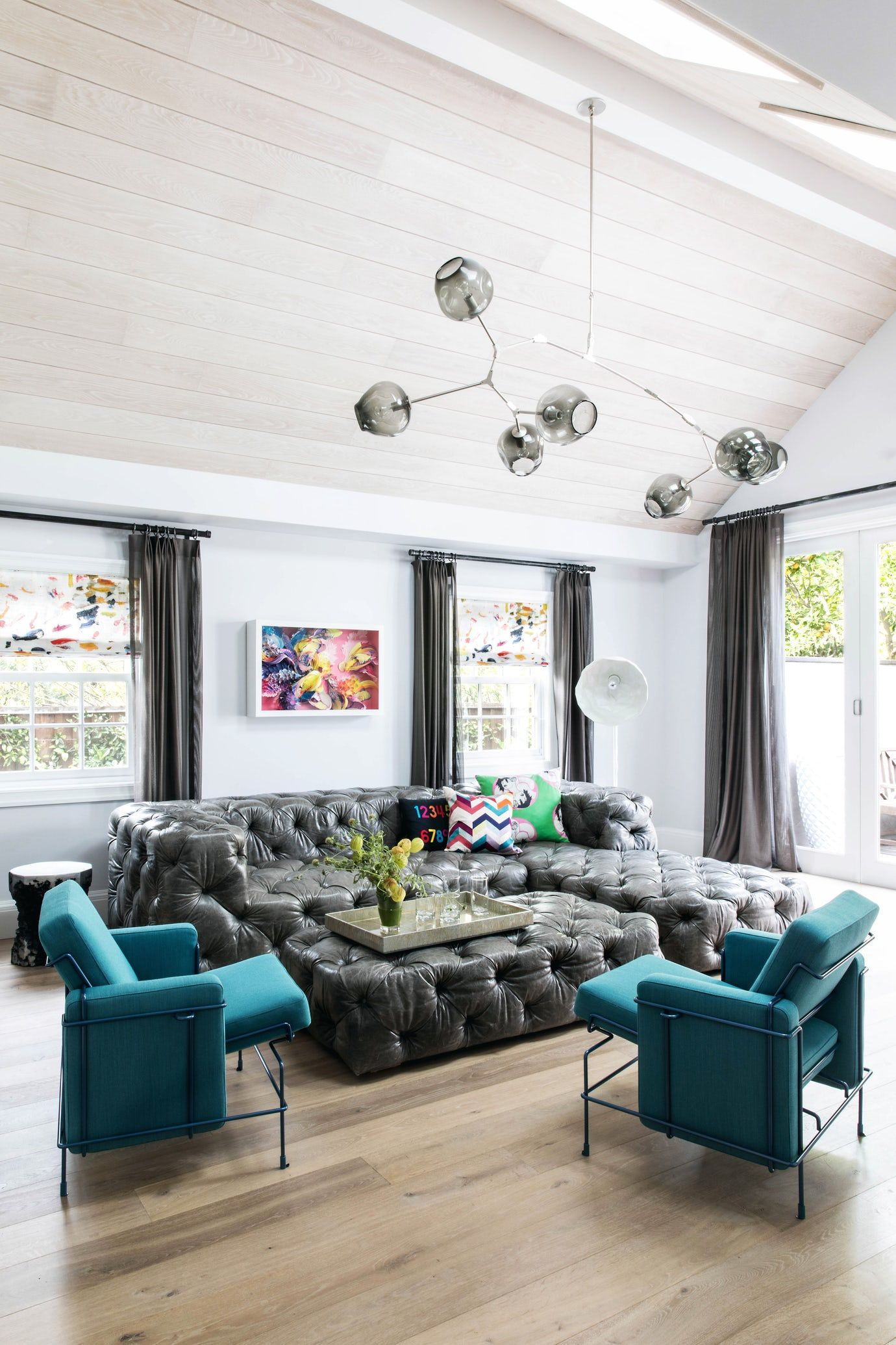 sitting area with oversized tufted sectional peaked