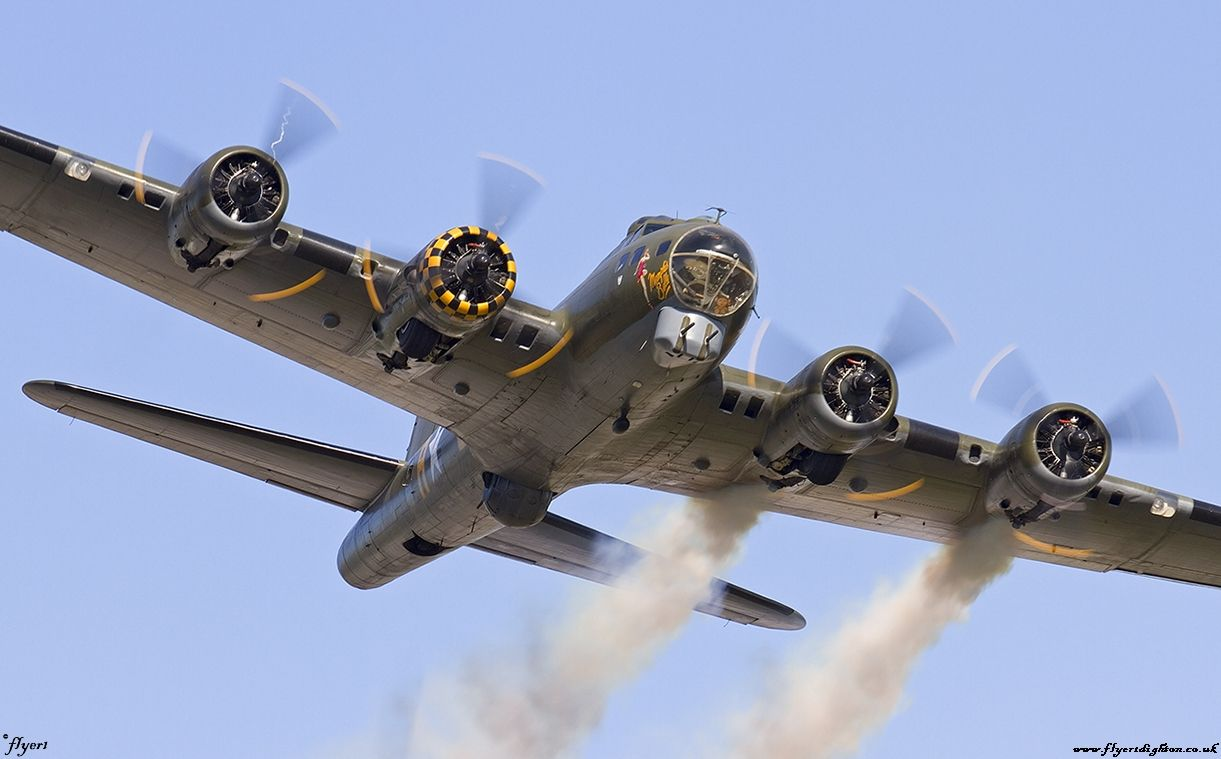 Boeing B-17G [229] Flying Fortress G-BEDF [cn.8693]. 'Sally B' with simulated smoke from engine fires makes a dramatic low pass at the RAFA Charity Shoreham EGKA/ESH Airshow 31.8.2013. Captured air-side.
