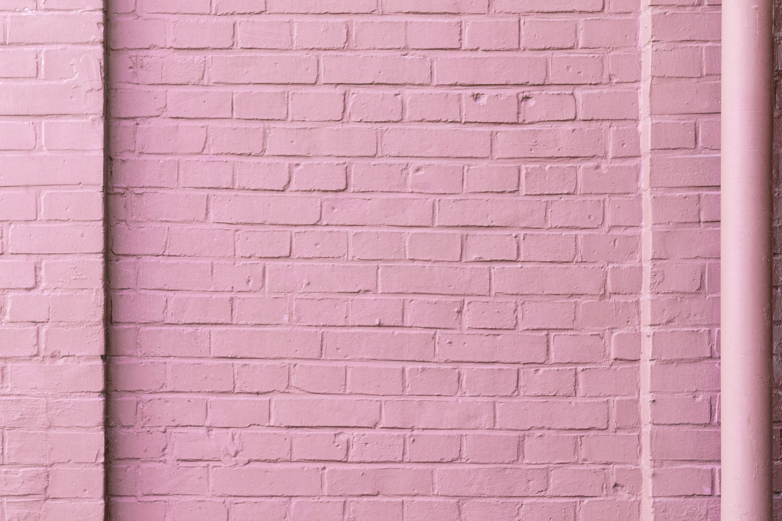 Pink Brick Wall And A Gutter Photo By Pawel Czerwinski Pawel Czerwinski On Unsplash Brick Images Pink Wallpaper Textured Background