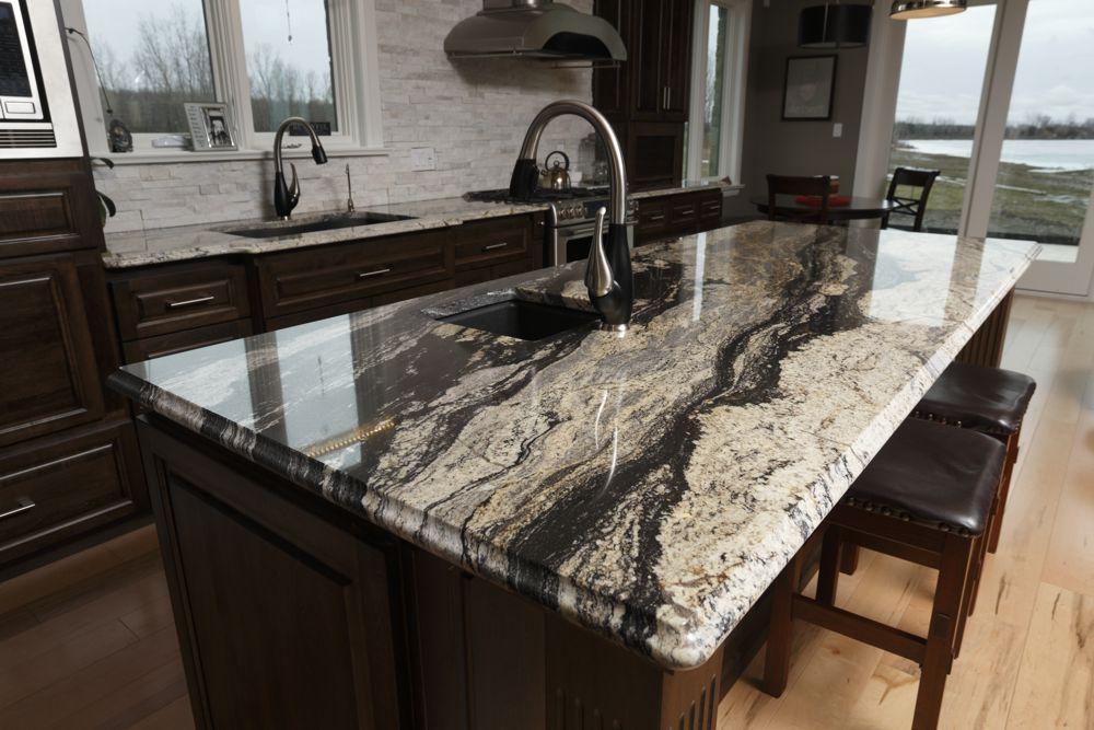 Image result for supreme granite with dark cabinets