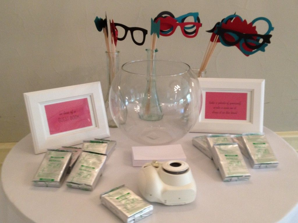 Pin by celina marie on wedding planning pinterest diy photo this bride and groom had a fun do it yourself photo booth they set up a table with a polaroid camera and masquerade inspired disguise glasses solutioingenieria Image collections