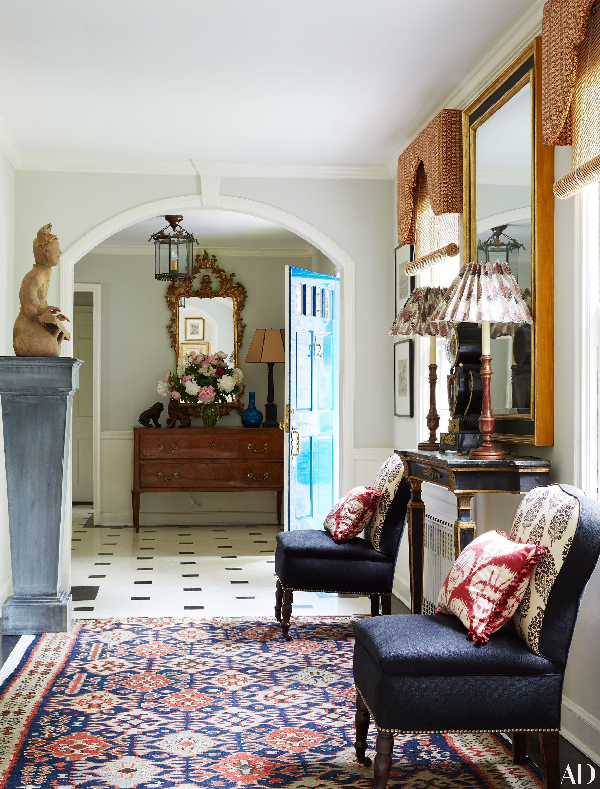 An antique Turkish kilim enlivens the entry hall | archdigest.com