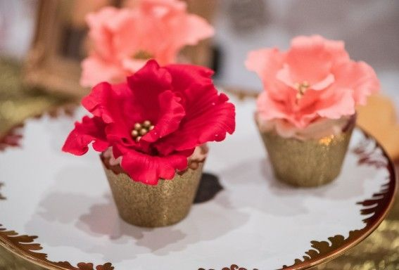 Flower adorned cupcakes by Fruitilicious Creations & Cakes