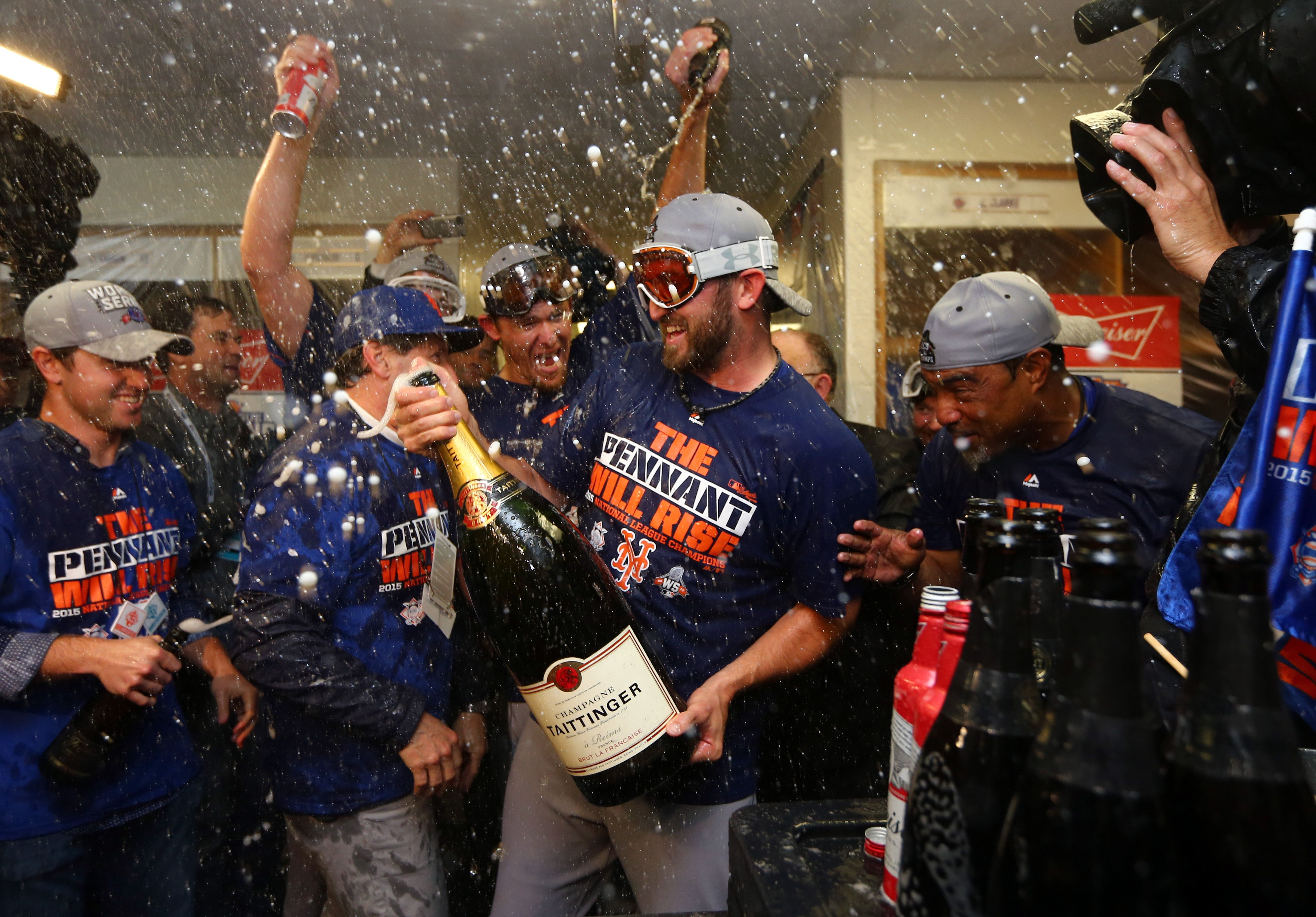 New York Mets players celebrate after Game 4 of the