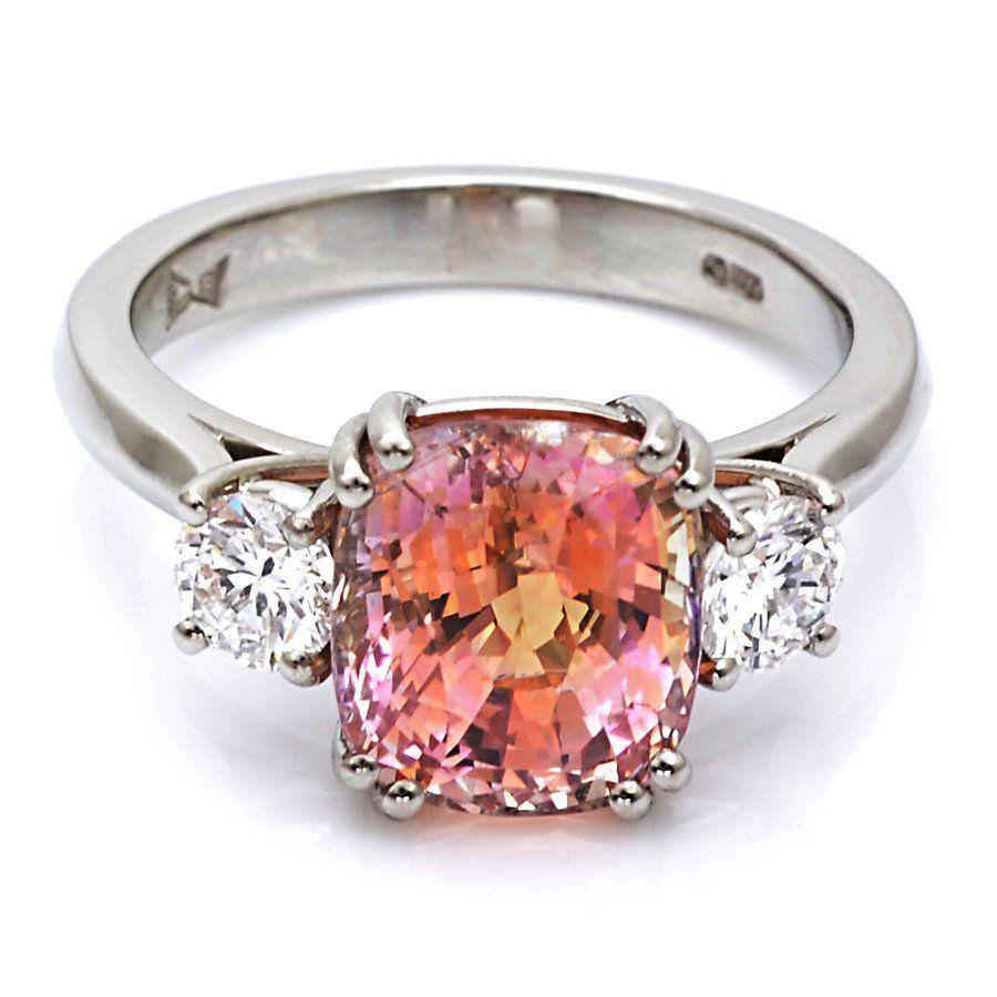 Platinum padparadscha sapphire and diamond trilogy ring sapphire