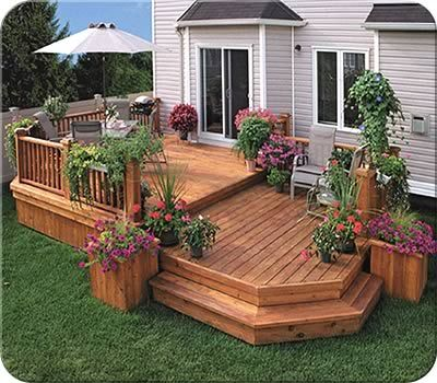 This Twolevel Deck Design Creates An Eating Area And A Sitting Area Adorable Backyard Deck Designs