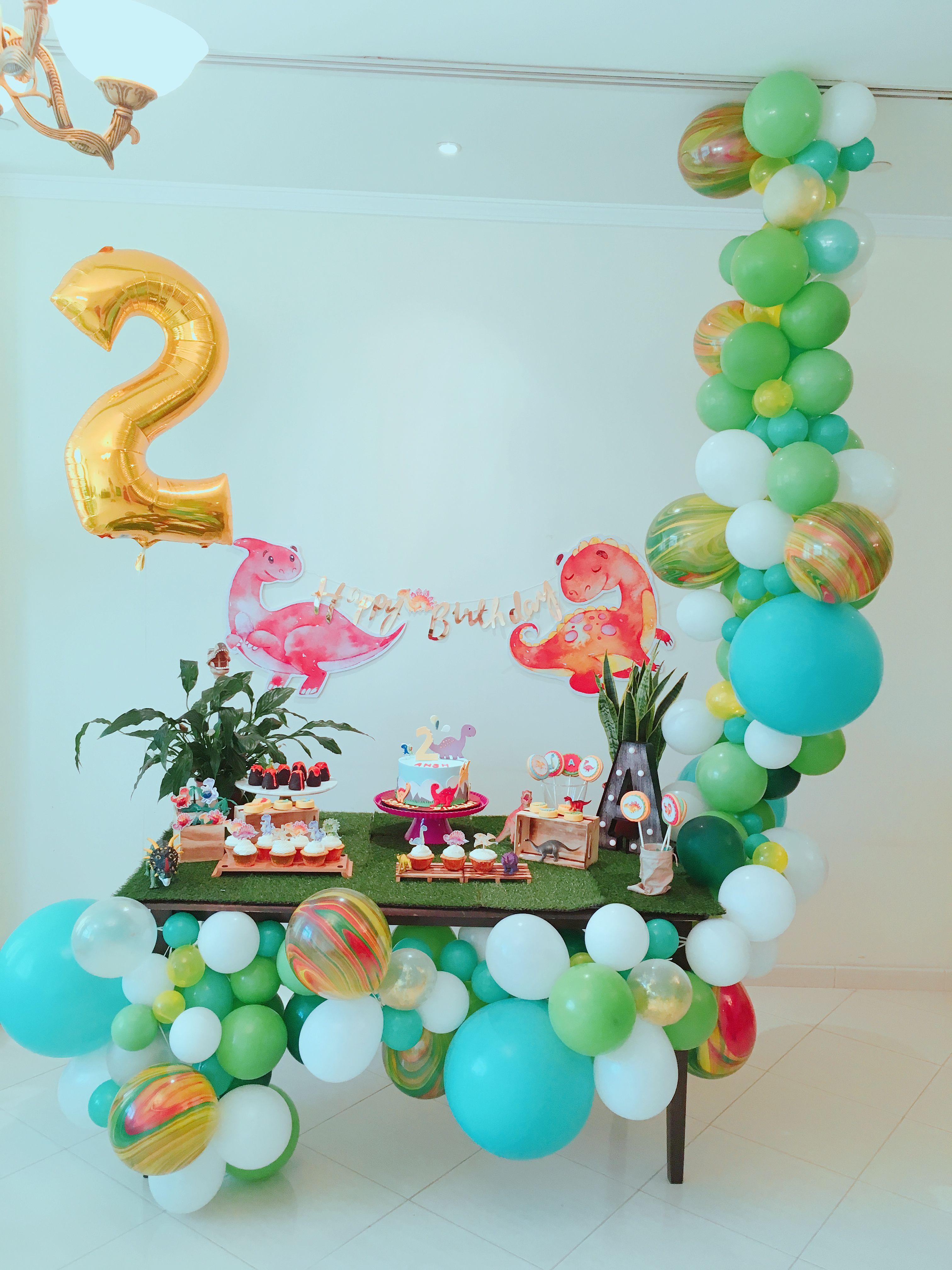 Dinosaur Theme Birthday Dessert Table Setup With Balloon Garland