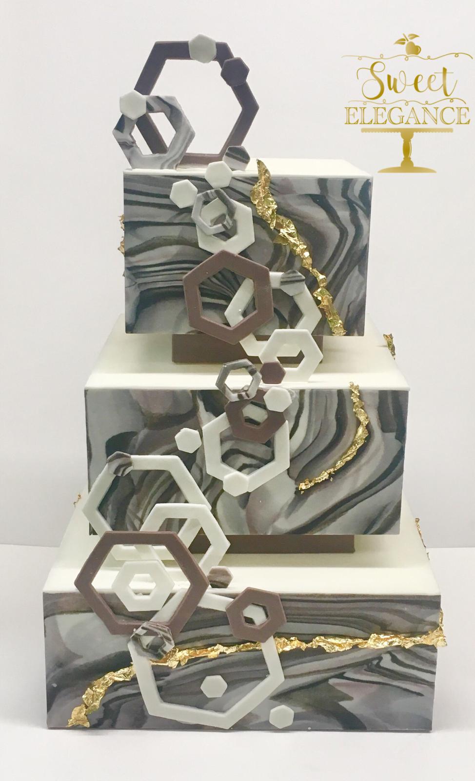 Amazing modern geometric wedding cake marbled fondant and gold