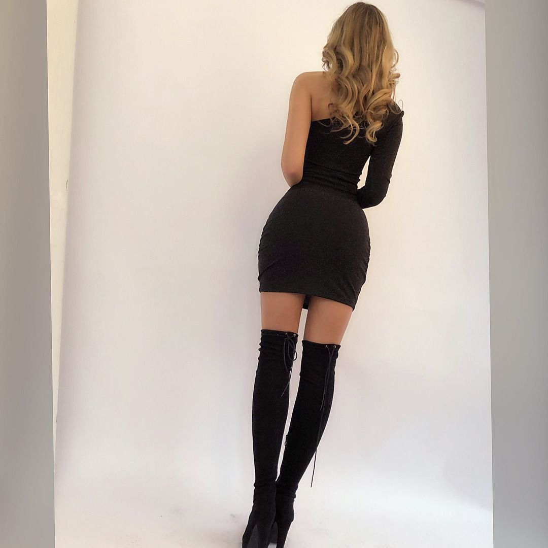 89927f9a4f4 Black thigh high boots combined with very short dress shorts skirt ...