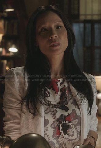 Joan's white top with abstract pink print on Elementary. Outfit Details: http://wornontv.net/23098/ #Elementary