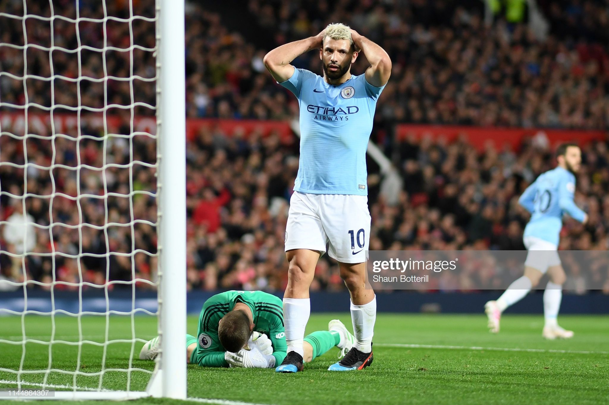 Sergio Aguero of Manchester City reacts after a missed chance as ...