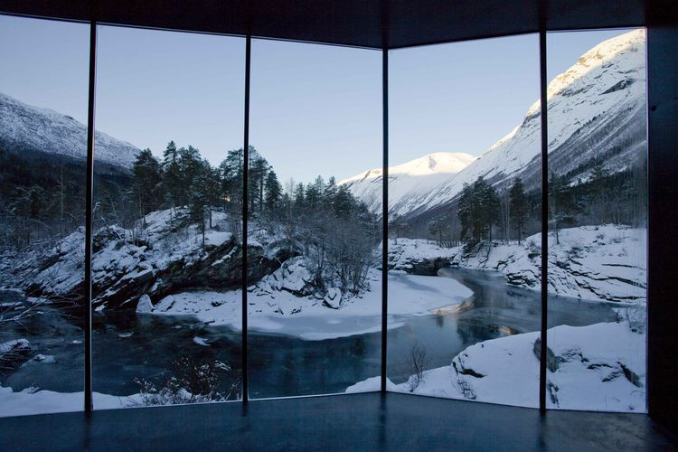 Juvet hotel in Norway with windows overlooking the Valldola River