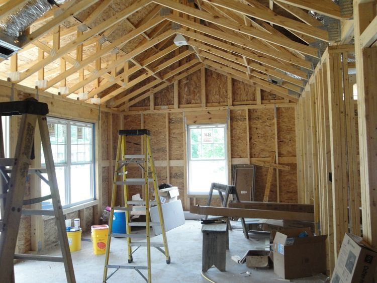 Using a scissor truss allowed us to vault the ceiling at ...