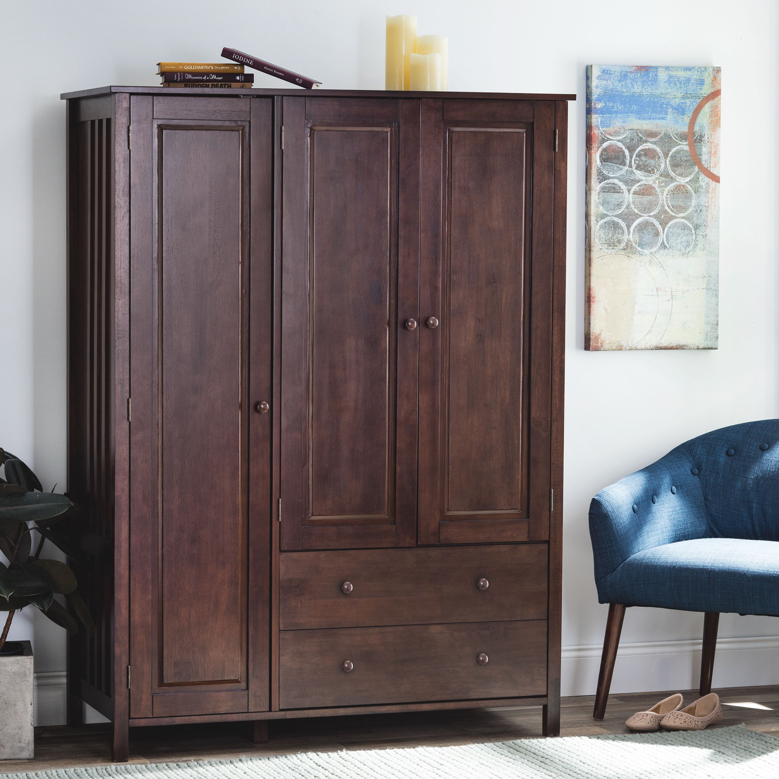 This wenge finish wardrobe features multiple compartments including