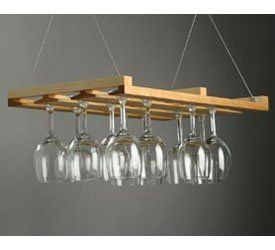 """Hanging Stemware Rack (Natural) (24"""" x 13"""" x 2"""") by J.K. Adams. $59.97. This elegant hardwood stemware rack can accommodate 18-24 wine glasses.. Size: 24"""" x 13"""" x 2"""". The wood wine glass rack suspends by hi-tech steel aircraft grade cables.. The hanging wine glass rack has three rows with access from each side. Peg stops prevent slippage.. Color: Natural. This elegant hardwood stemware rack can accommodate 18-24 wine glasses. The wood wine glass rack suspends by hi-tech s..."""