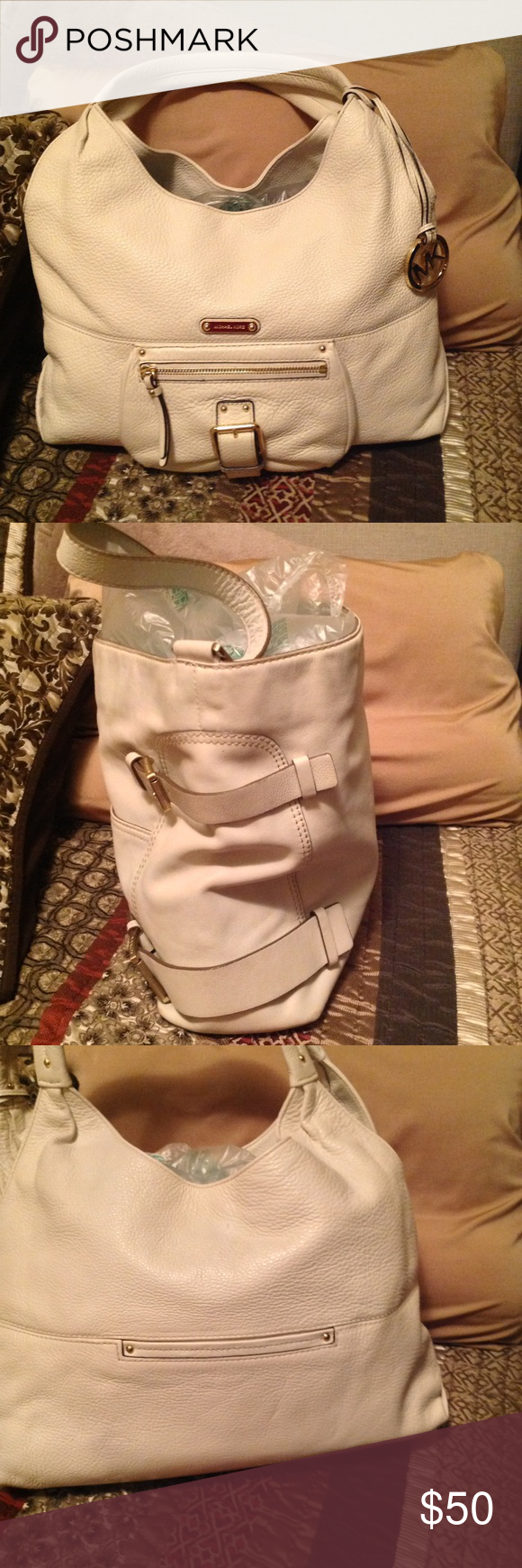 Michael Kors cream hand bag Michael Kors cream leather double strap purse. Back pocket lots of room good condition. Michael Kors Bags