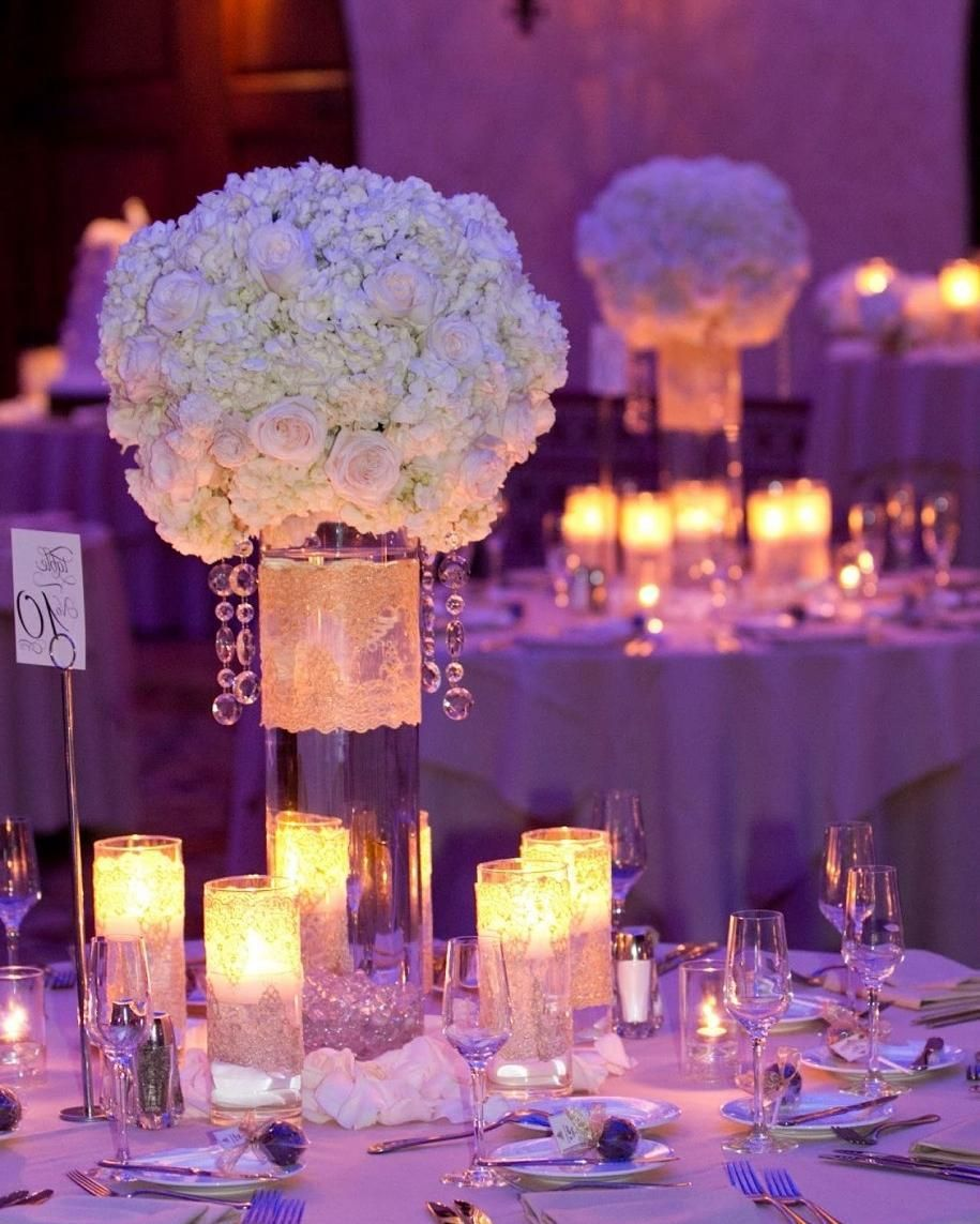 Purple Wedding Ideas With Pretty Details: Unique #centerpieces Glow Nicely Under #uplight Lighting