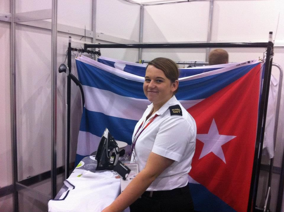 Ab (wtr) Becky Hassall, Preparing the flags for the judo victory ceremony.
