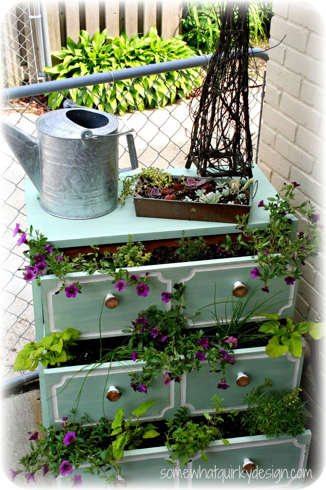 old dresser loaded with flowers - by Bella Nest. Pretty!  Great display idea for my shop with artificial flowers!