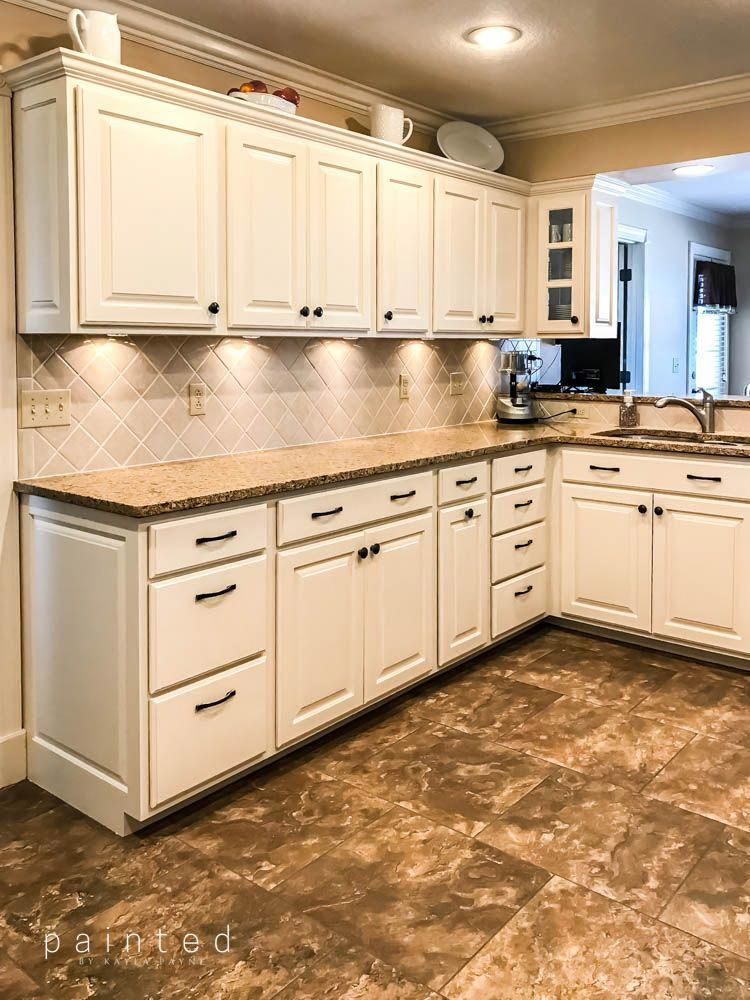 Painting these oak cabinets brightened up the is kitchen ...