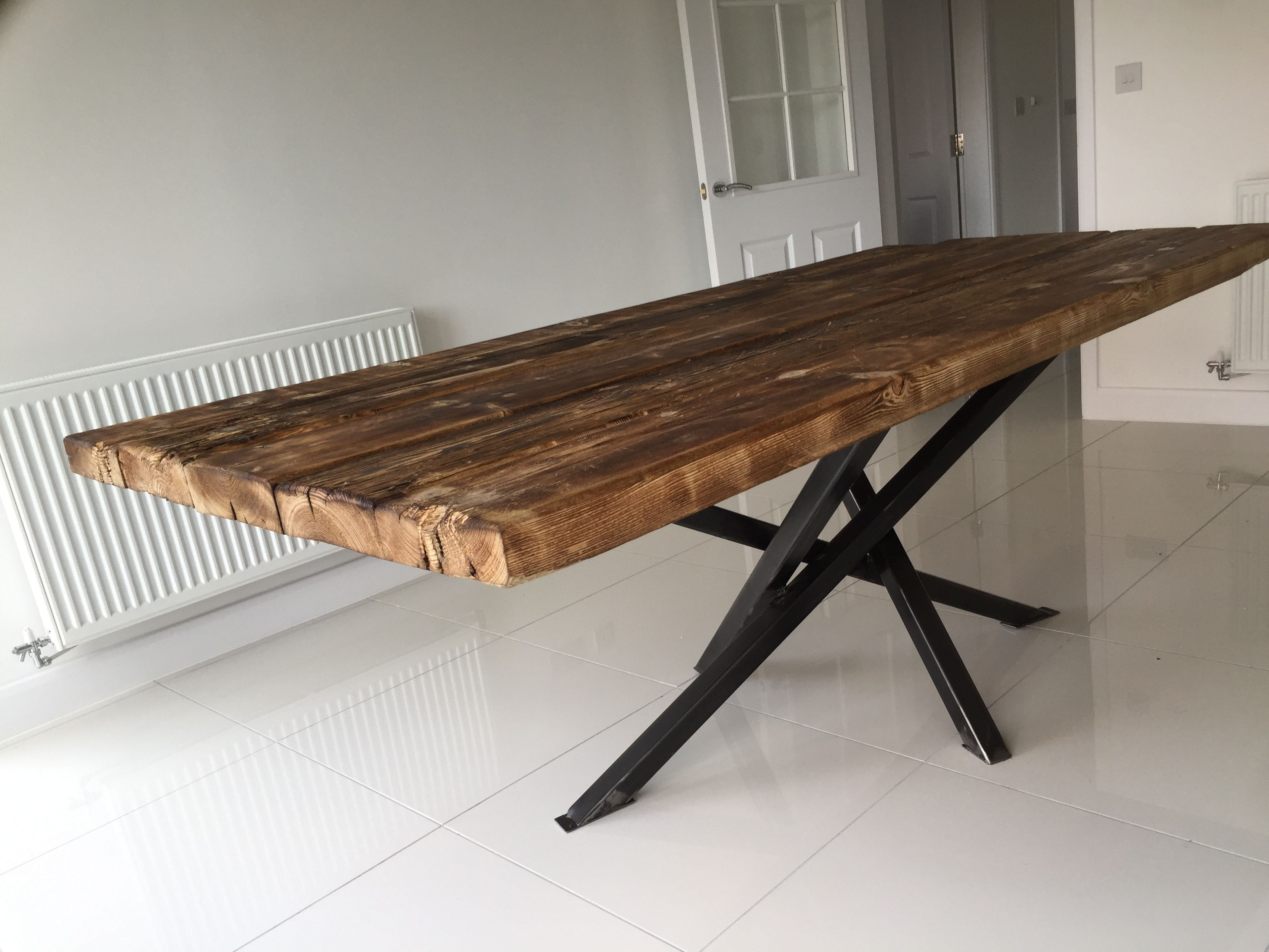 The old modern by Rusty Wood.. Reclaimed timber top on modern steel ...