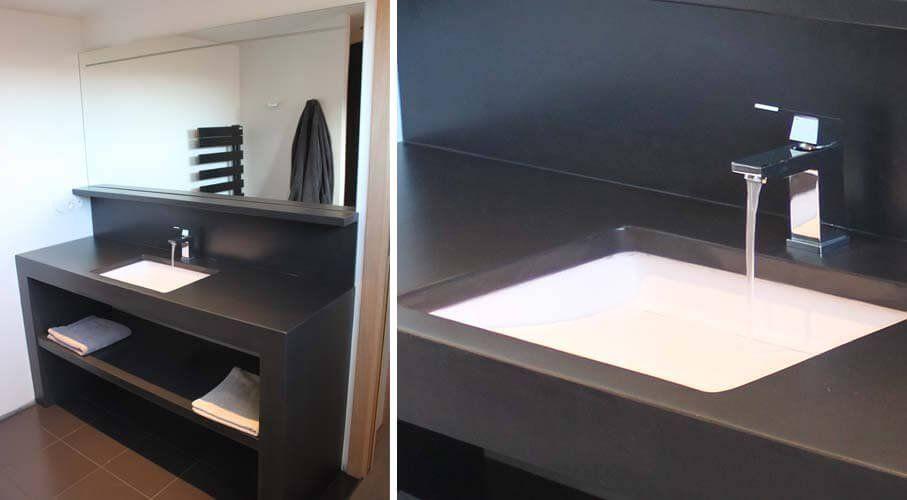 Lavabo collé sous plan pour ce meuble moderne en béton ciré