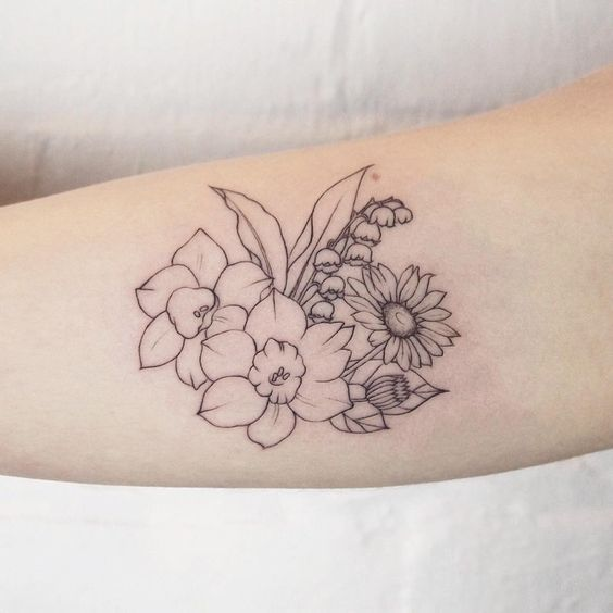 Simple Floral Arrangement Narcissuses Lily Of The Valley And Daisy Tattoo People Toronto Jess Chen Daffodil Tattoo Birth Flower Tattoos Tattoos