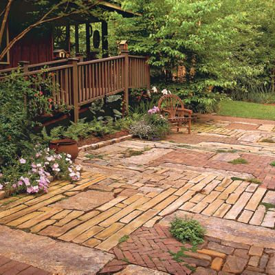 I really like this patchwork brick patio. and it might even be cheaper as you could buy end of line materials and it would not matter if you didn't have a lot of it as you are going to use so many different ones..  perfect ground for patio