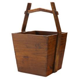 Wood bucket in distressed natural with a yoke-style handle.   Product: BucketConstruction Material: Wood  Color: Distressed natural     Features:  Yoke-style handleDimensions: 20 H x 11 W x 11 D