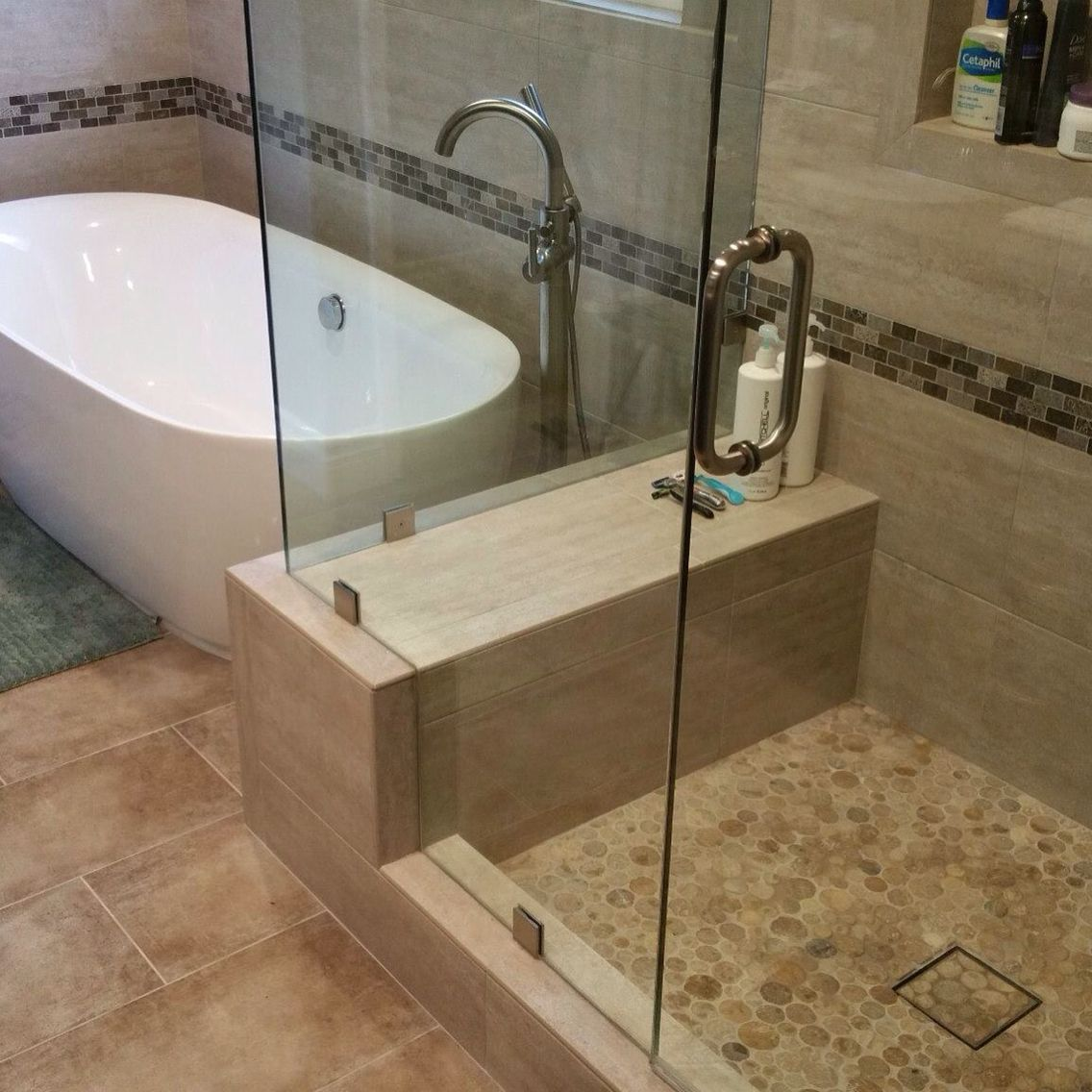 Travertine natural stone bathroom remodel. With modern glass shower ...